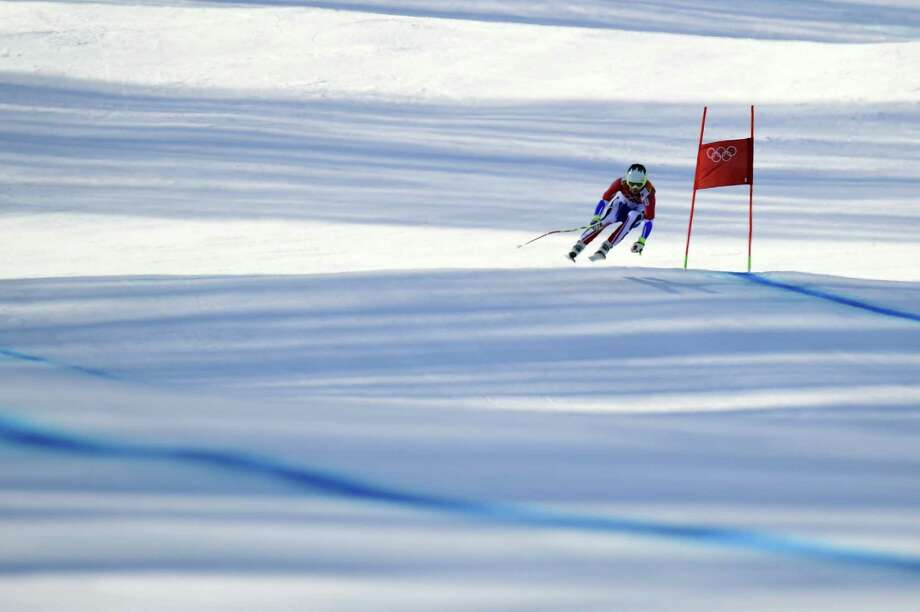 France's Alexis Pinturault competes during the Men's Alpine Skiing Super Combined Downhill at the Rosa Khutor Alpine Center during the Sochi Winter Olympics on February 14, 2014. Photo: OLIVIER MORIN, AFP/Getty Images / 2014 AFP