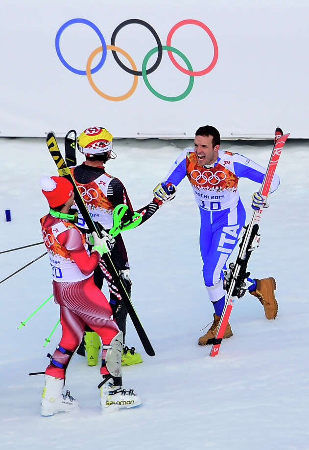 (L-R) Gold medallist Switzerland's Sandro Viletta, silver medallist Croatia's Ivica Kostelic and bronze Italy's Christof Innerhofer celebrate after the Men's Alpine Skiing Super Combined Slalom at the Rosa Khutor Alpine Center during the Sochi Winter Olympics on February 14, 2014. Photo: OLIVIER MORIN, AFP/Getty Images / 2014 AFP