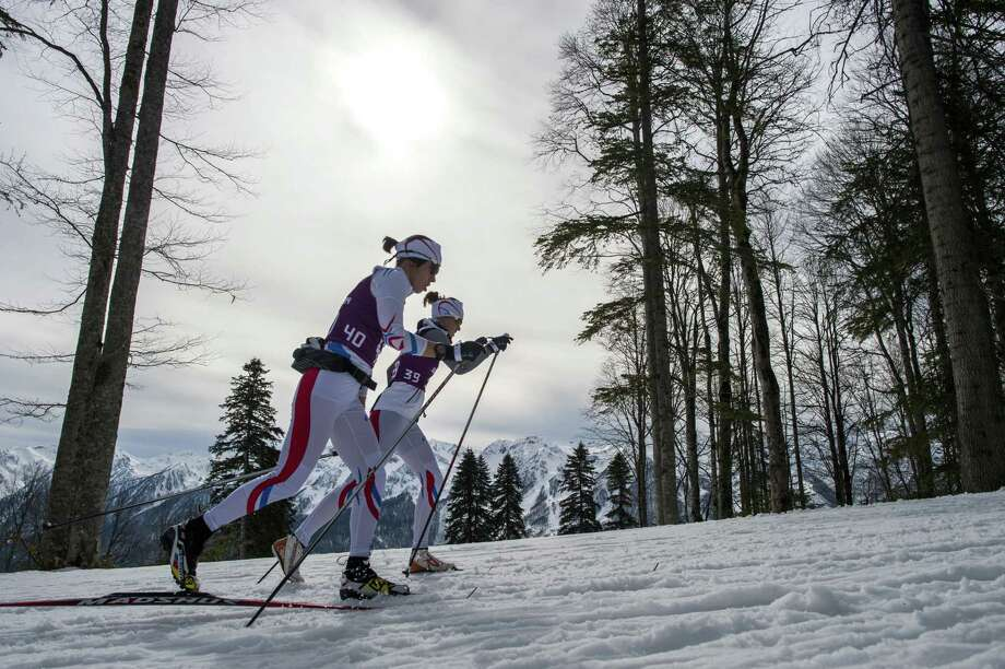 Finland's Sami Jauhojaervi  (40) and Canada's Ivan Babikov (39) compete  in the Men's Cross-Country Skiing 15km Classic at the Laura Cross-Country Ski and Biathlon Center during the Sochi Winter Olympics on February 14, 2014 in Rosa Khutor near Sochi. Photo: ODD ANDERSEN, AFP/Getty Images / 2014 AFP