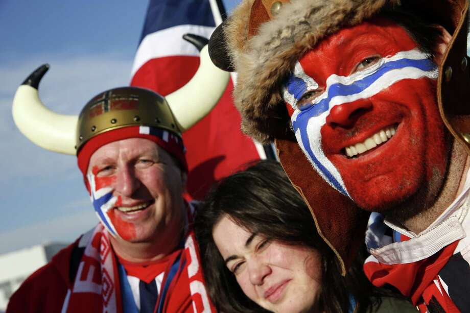 Norwegian visitors pose for a photograph at the Olympic Park in Sochi on February 14, 2014 during the 2014 Sochi winter Olympics. Photo: ADRIAN DENNIS, AFP/Getty Images / 2014 AFP