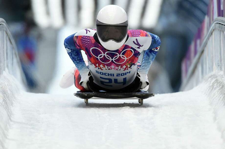 South Korea's Lee Hansin brakes after finishing the Men's Skeleton Heat 1 of the Sochi Winter Olympics on February 14, 2014 at the Sanki Sliding Center. Photo: LEON NEAL, AFP/Getty Images / 2014 AFP