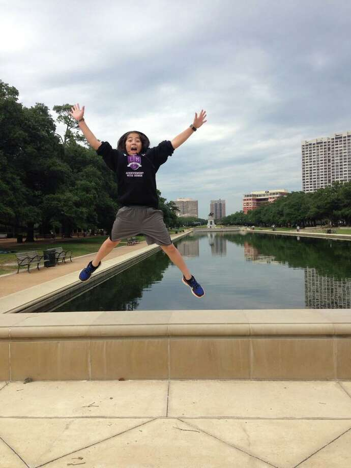"""""""A big hug to you, Houston!"""" My daughter at the Hermann Park Reflection Pool one spring day.Joanne Wilson"""