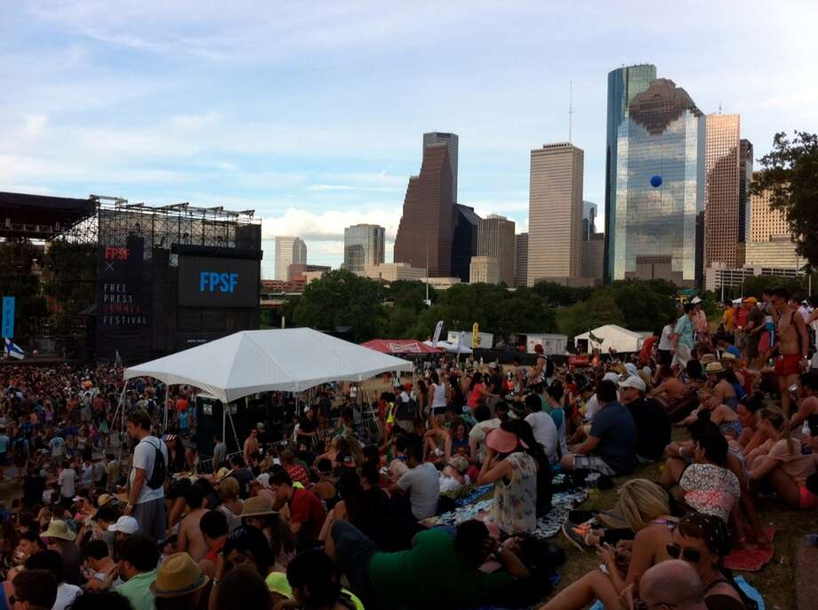 I tell my nature-loving husband that the skyline and buildings are my mountains. I smile every time I see downtown. This picture captures the great music, people and weather in Houston...all in the shadow of a big city!Julia Rice