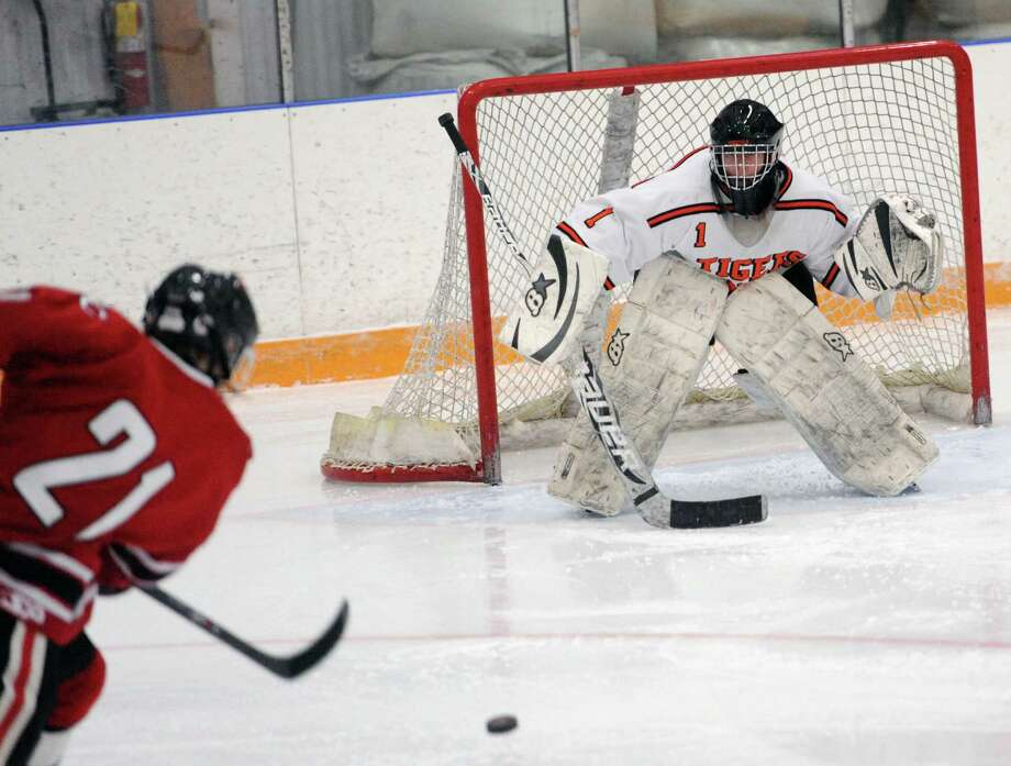 Photos from Ridgefield's 5-4 win over New Canaan in the high school boys hockey game at the Winter Garden Arena in Ridgefield, Conn. on Wednesday, Feb. 12, 2014. Photo: Tyler Sizemore / The News-Times
