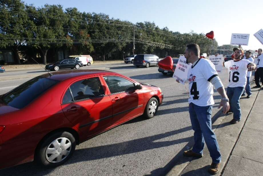 Brad Brown looks for a Valentine's date in rush hour traffic. (Photo by Cody Duty/Houston Chronicle)