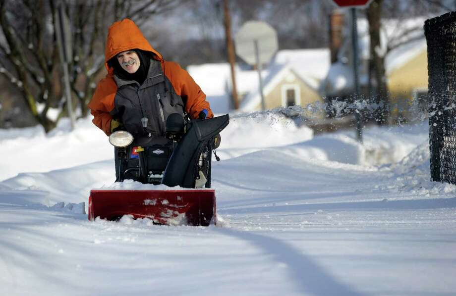 "Antonio Heieor struggles to get his snowblower through the deep snow at Broadview Middle School Friday morning, Feb. 14, 2014. He's been working at the school for 15 years and he says of the snow, "" I never saw this - it's too much."" Photo: Carol Kaliff / The News-Times"
