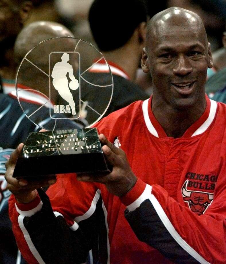 1996 - Michael Jordan East 129, West 118 San Antonio 20 points, 4 rebounds, 1 assist and 1 steal Photo: DAVID PHILLIP, ASSOCIATED PRESS