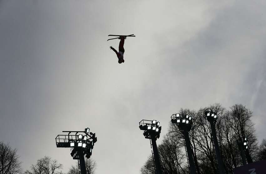 China's Xu Mengtao jumps during the women's freestyle skiing aerials qualifying at the Rosa Khutor Extreme Park, at the 2014 Winter Olympics, Friday, Feb. 14, 2014, in Krasnaya Polyana, Russia.