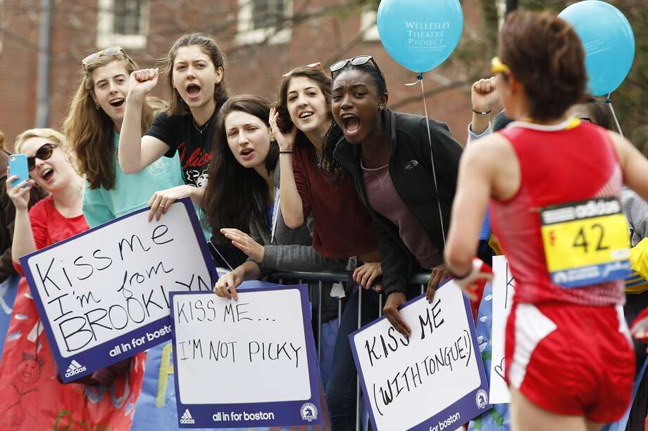 Top cities for single women11. Boston. (Wellesley College students cheer runners at the Boston Marathon, 2013). Photo: Boston Globe, Boston Globe Via Getty Images