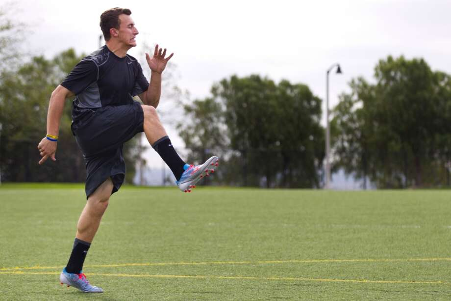 Johnny Manziel does high knee kicks while working out in preparation for the NFL draft. Photo: Brett Coomer, Houston Chronicle