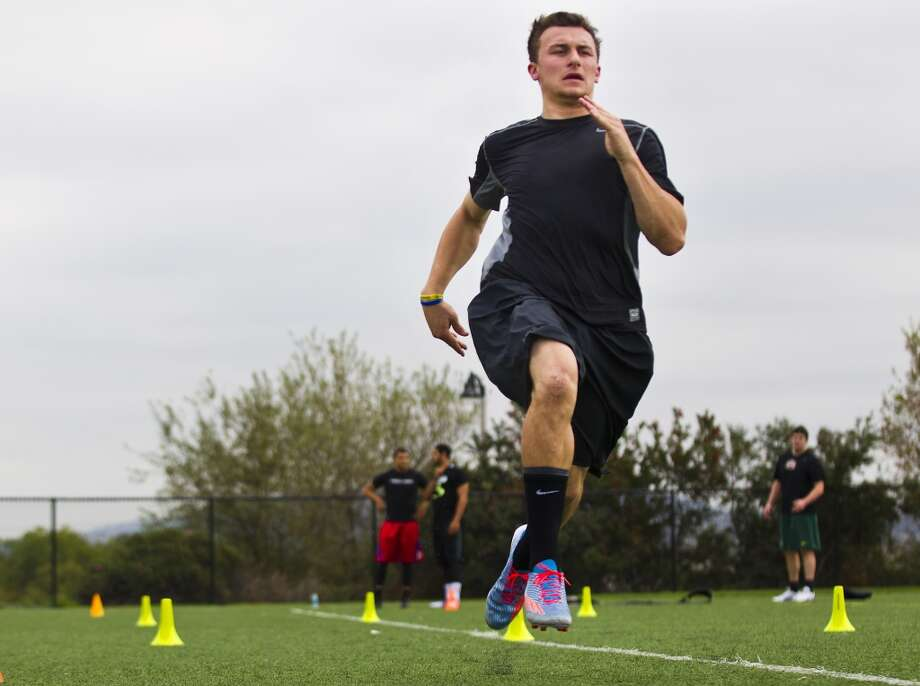 Johnny Manziel runs a sprint while working out in preparation for the NFL draft. Photo: Brett Coomer, Houston Chronicle