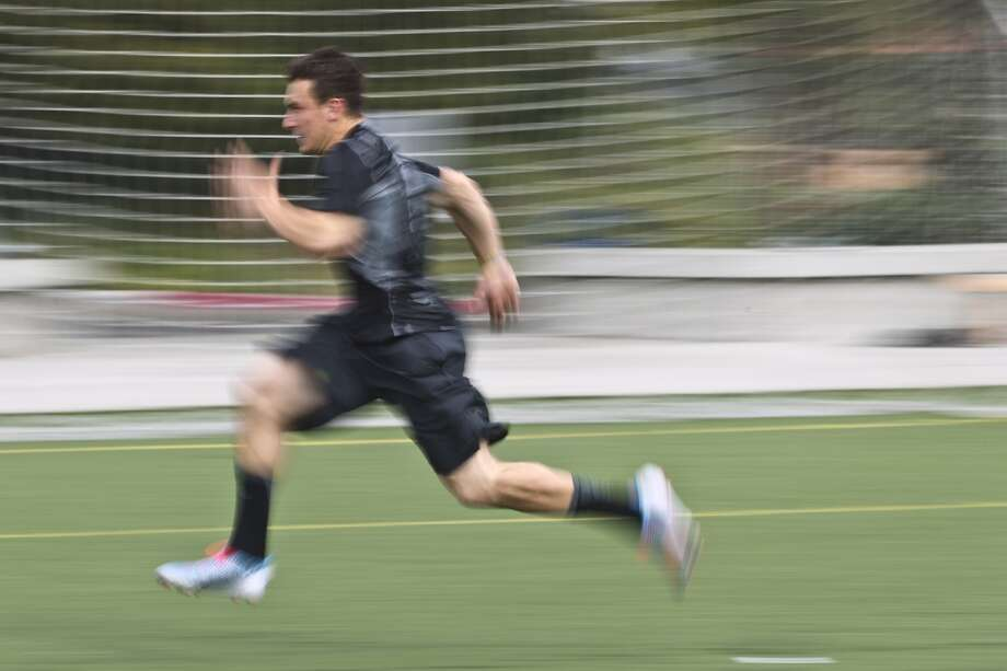 Johnny Manziel runs a sprint while working out in preparation for the Photo: Brett Coomer, Houston Chronicle