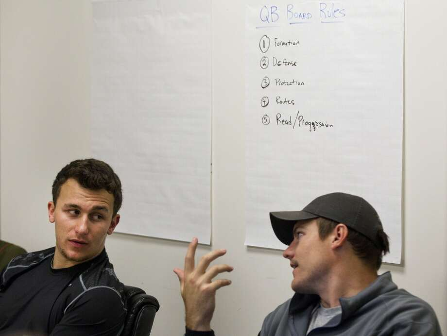 Johnny Manziel talks to former NFL quarterback Kevin O'Connell during a classroom session while preparing for the NFL draft. Photo: Brett Coomer, Houston Chronicle