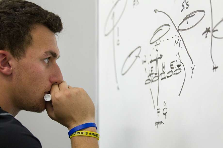 Johnny Manziel studies a play and works on reading pass coverages during a classroom session while preparing for the NFL draft. Photo: Brett Coomer, Houston Chronicle