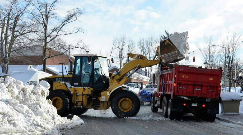 Town workers remove snow from the corner of Park and Pine streets in New Canaan Friday morning, Feb. 14, 2014. Photo: Nelson Oliveira / New Canaan News