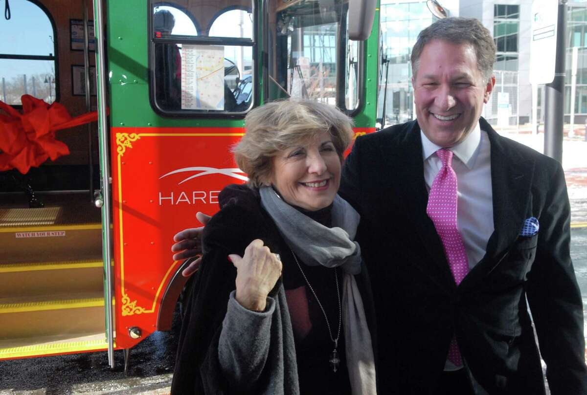 Carl Kuehner, Building and Land Technology's Chief Executive Officer, and Sandy Goldstein, President of Stamford Downtown, get ready tp cut the ribbon for the inaugural ride on the Harbor Point Trolley in Stamford, Conn. on Friday February 14, 2014.