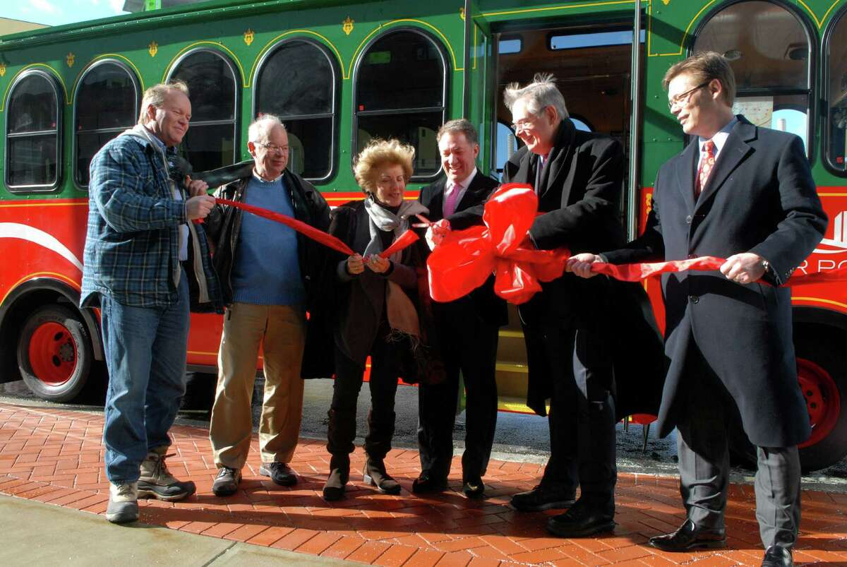 Tom Mills, Norman Cole, Sandy Goldstein, Carl Kuehner, David Martin and John Freeman cut the ribbon for the inaugural ride on the Harbor Point Trolley in Stamford, Conn. on Friday February 14, 2014.