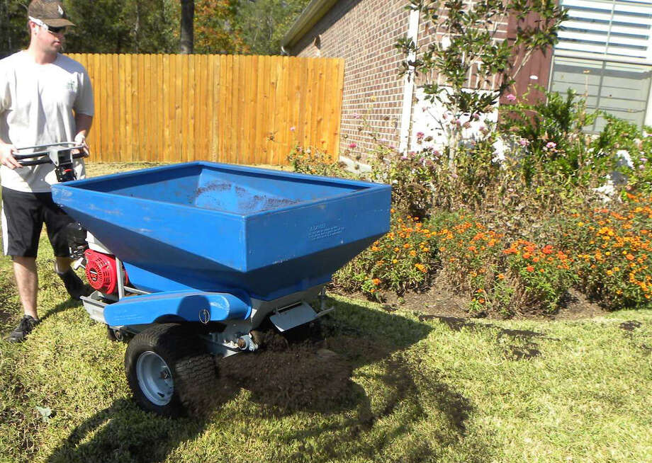 This is the time of year to aerate your lawn. Then top dress it with a half-inch application of pure compost. Photo: Houston Chronicle File Photo