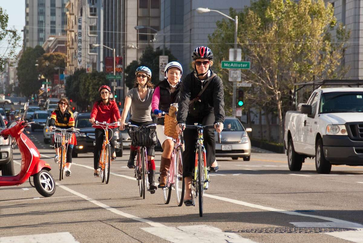District 6 commuter convoy arrives at City Hall with Supervisor Jane Kim, second from right, during Bike to Work Day in 2012