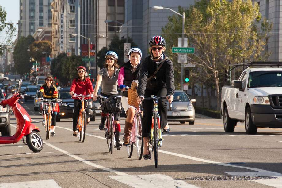 A District 6 commuter convoy arrives at City Hall with Supervisor Jane Kim, second from right, during Bike to Work Day in 2012. Photo: SF Bicycle Coalition