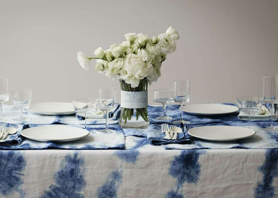 A table is set with an OriShibori tablecloth, runner, placemats and napkins. Photo: David Malosh / Associated Press / OriShibori.com