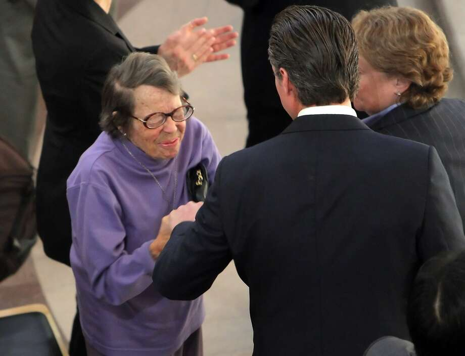 February 12, 2014: Phyllis Lyon squeezes Lt. Gov. Gavin Newsom's hand after he addressed a crowd of several hundred same-sex marriage supporters who gathered at City Hall in San Francisco to remember the 10th anniversary of the lifting of a ban on weddings for gay and lesbian couples. Lyon and her long-time partner, Del Martin, were the first gay or lesbian couple to marry in California. The action by then-Mayor Gavin Newsom paved the way for the legalization of same-sex wedding in many states across the nation. Photo: Carlos Avila Gonzalez, The Chronicle