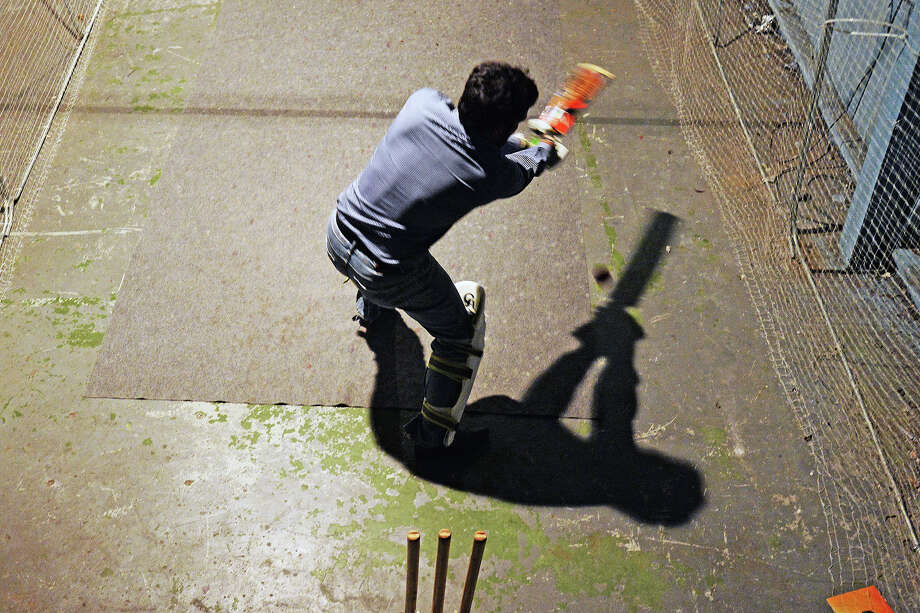 The Beaumont Jags cricket player Irfan Khan takes a swing while at bat during Thursday nights practice in a warehouse behind The Smoke Shop. The Beaumont Jags has been around for two years and are coming off a Southeast Texas Cricket League title. Michael Rivera/@michaelrivera88