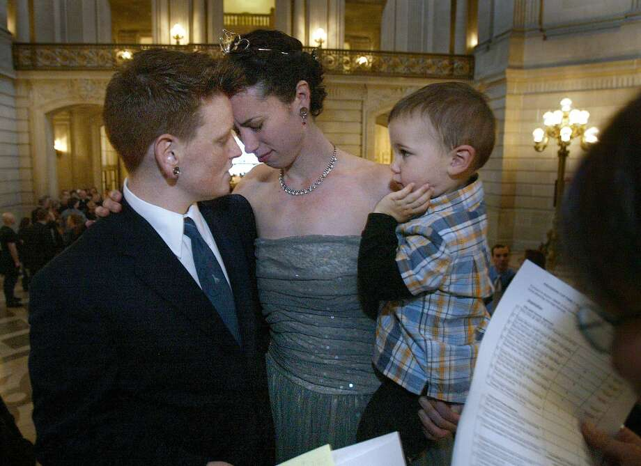 February 16, 2004: Mabel Teng marries Heather Smioly (right with dress) to Cole Blevins as Heather's son Ezekiel Bornstein witness the ceremony on the inside steps of San Francisco City Hall. Photo: Frederic Larson, SFC