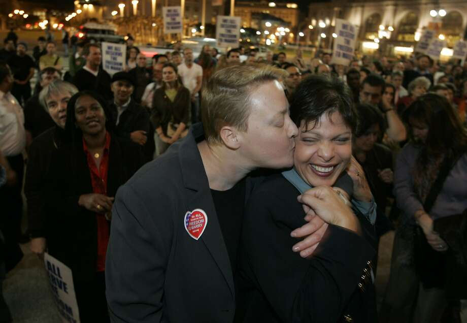March 14, 2005:  Leslie Lewis (left) kisses her wife Doris Bersing on the steps of City Hall during the rally  to celebrate the court ruling that Gay Marriage is legal. The march went from 18th Street and Castro to City Hall. Photo: John Storey, SFC