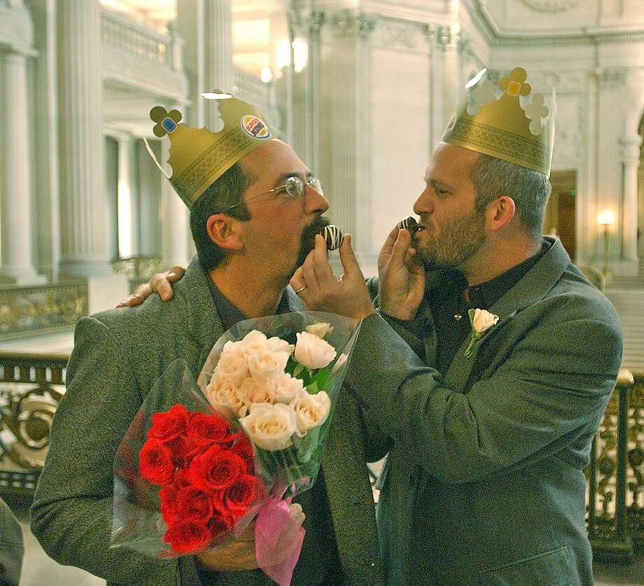 February 24, 2004:Newlyweds Kevin Cahill, left, and Chip Lenno share a piece of chocolate after their wedding vows were taken at City Hall in San Francisco.   President Bush calls on Congress to quickly pass an amendment banning same-sex marriages. Photo: Ben Margot, AP