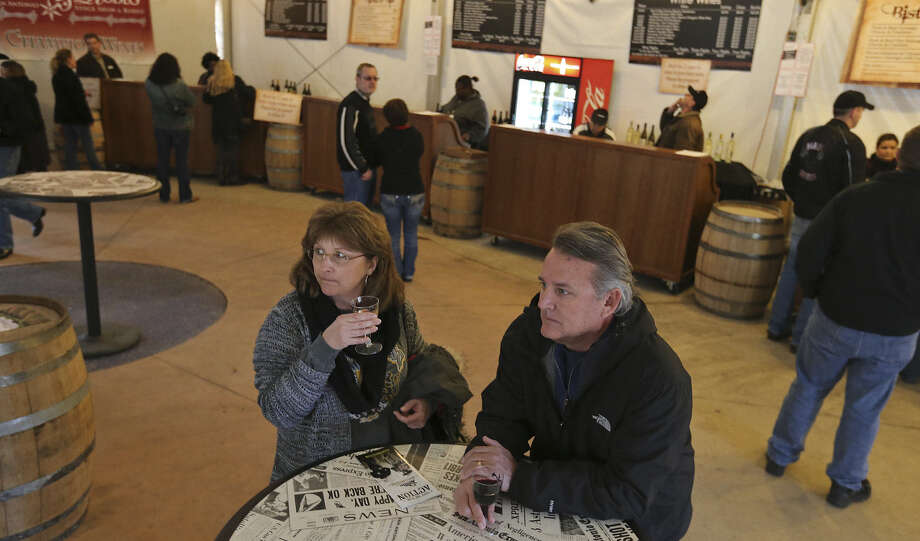 Tina and John Vroman take a break in the wine garden, where more than 50 wines are available for sale and sampling. Photo: Edward A. Ornelas / San Antonio Express-News / © 2014 San Antonio Express-News