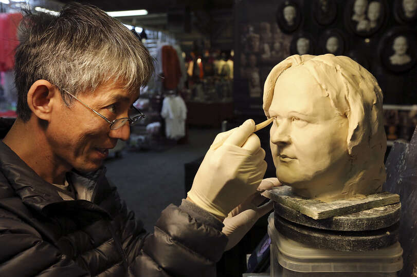 Face sculpture artist Hoo Tian works on a piece during the livestock show Monday. In about 30 minute