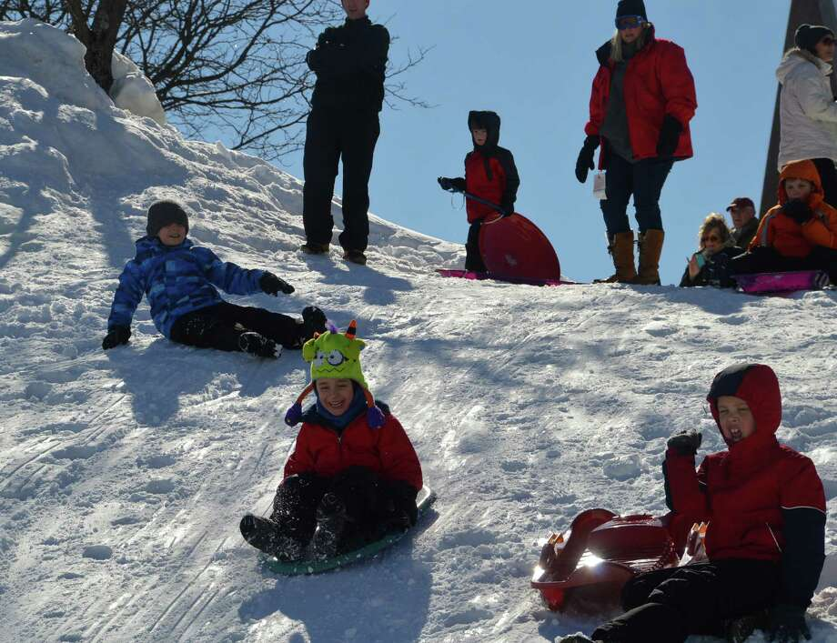 Kids were only too happy to be at Greens Farms Elementary on Friday, since classes were cancelled in the wake of Thursday's storm and sledding was the assignment of the day. Photo: Jarret Liotta / Westport News contributed