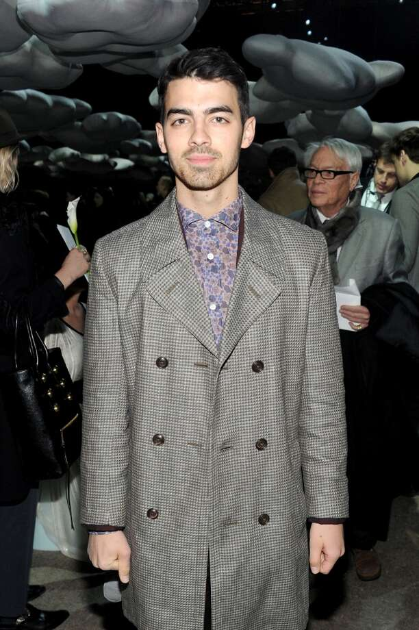 Joe Jonas attends the Marc Jacobs fashion show during Mercedes-Benz Fashion Week Fall 2014 at Lexington Avenue Armory on February 13, 2014 in New York City. Photo: Jamie McCarthy, Getty Images For Marc Jacobs