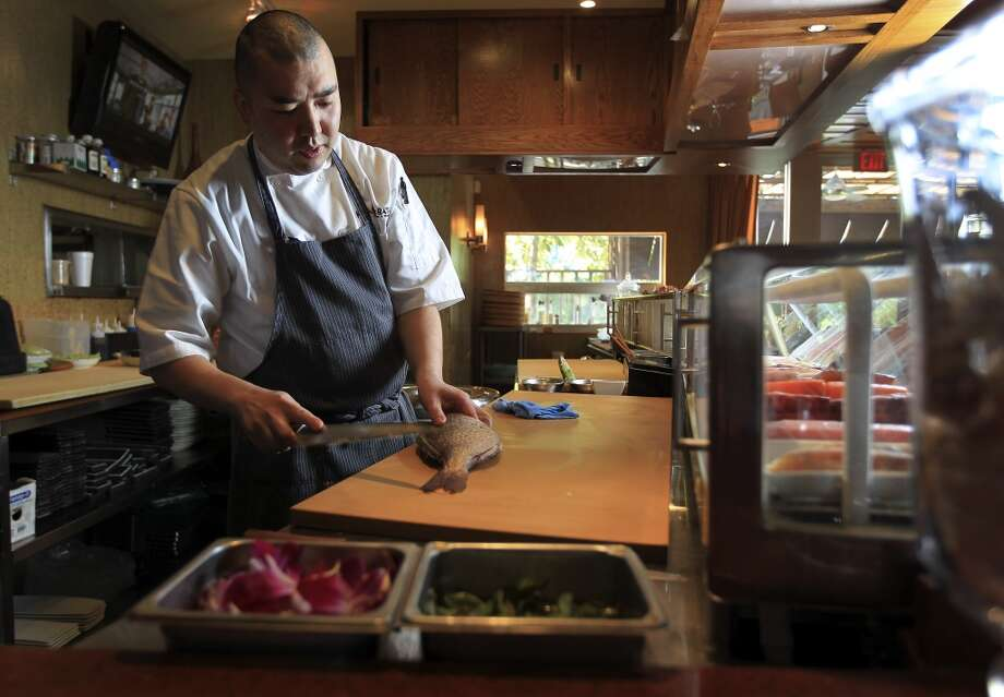 Chef Manabu Horiuchi of Kata Robata, cuts fish at the sushi bar. (Karen Warren / Houston Chronicle ) Photo: Karen Warren, Houston Chronicle