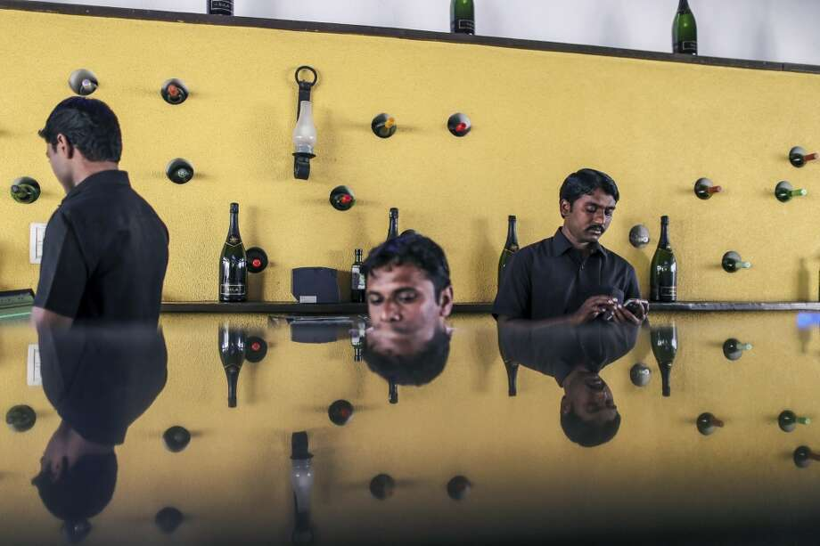 India: Bar enders wait for customers in the balcony bar of The Tasting Room at Sula Vineyards, operated by Nashik Vintners Pvt., in the Nashik Valley, Maharashtra, India. Photo: Dhiraj Singh, Bloomberg