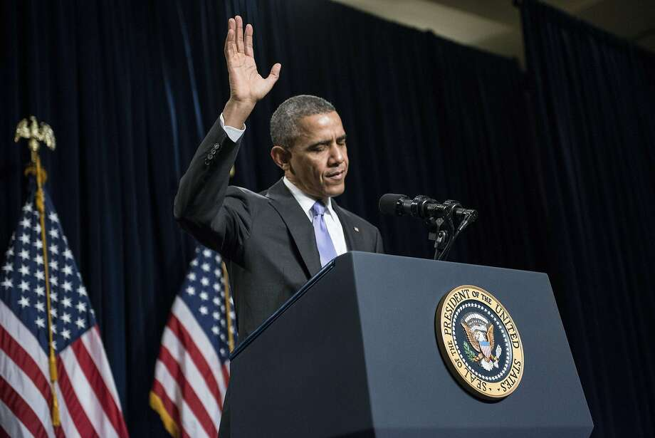 President Obama waves before speaking during the Democratic Issues Conference in Cambridge, Md. Photo: Brendan Smialowski, AFP/Getty Images