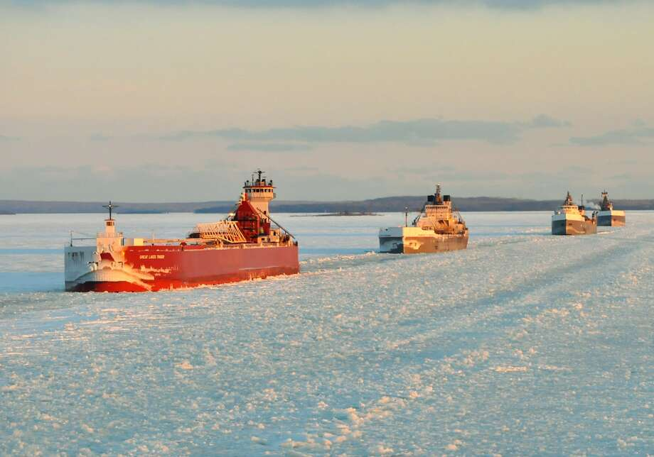 A convoy of cargo ships follows an icebreaker on the St. Marys River, which links Lakes Superior and Huron. The lakes hold nearly one-fifth of the freshwater on the world's surface. Photo: Lt. David Lieberman, Associated Press