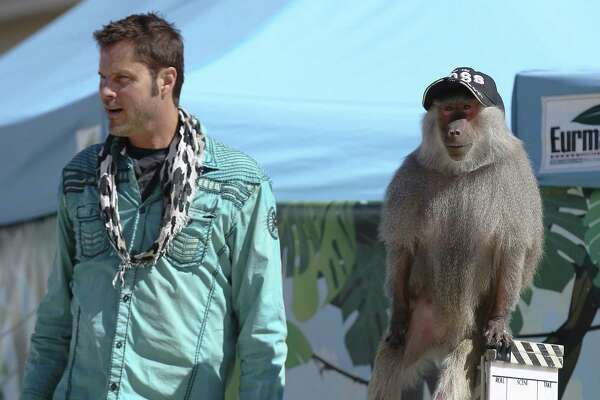 Kevin Keith  and Dagney, a baboon, perform during the Wild About Monkeys show in the Family Fair area.
