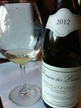 "Pouilly-Fuissé (poo-YEE fwee-SAY): An appellation that controls white wines in the French Burgundy region. Audio: Click here to hear the term ""Pouilly-Fuissé."" Photo: Wikimedia Commons"