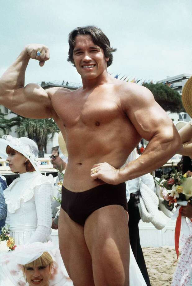 Arnold Schwarzenegger strikes a bodybuilder pose in May 1977. Photo: Staff / AFP