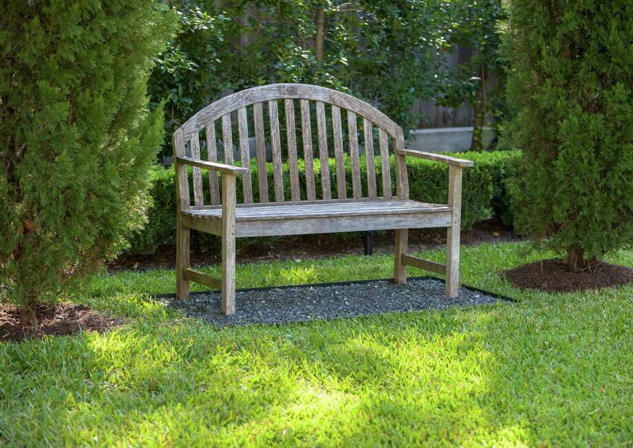 Details and overalls of lush private River Oaks garden designed by David Morello. Bench in garden.