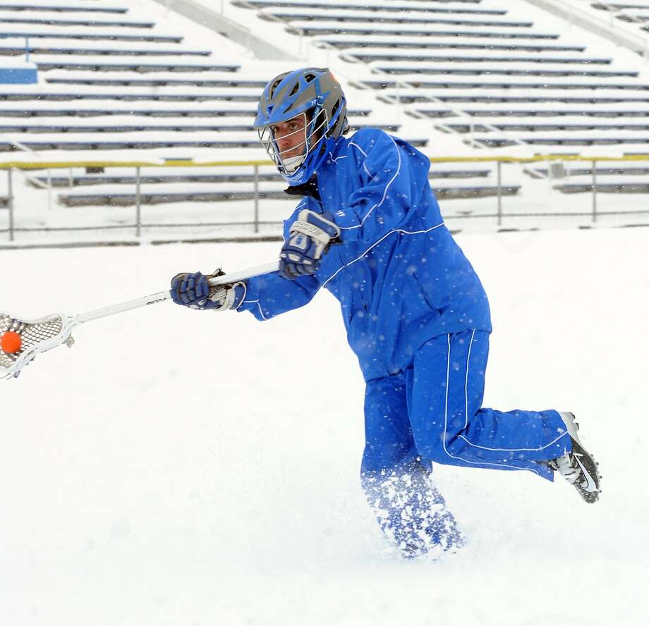 Skip practice because of a little snow? Not Brandon Ralston. The Fairmont Senior High School junior and serious lacrosse player can't wait for spring in Fairmont, W.Va. Photo: Tammy Shriver, Associated Press