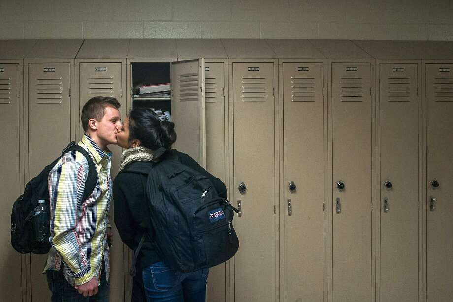 Lip locker: Grand Blanc High's Mariah Koolthong and boyfriend Teddy Krause do some last-minute cramming before a class in Grand Blanc Township, Mich. Photo: Jake May, Associated Press