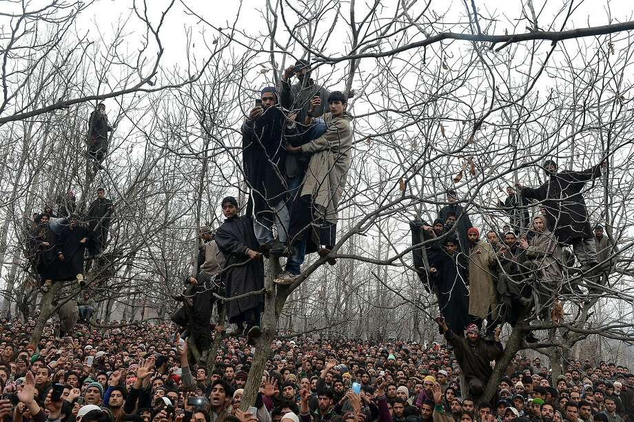 Shouting slogans of freedom, villagers crowd the funeral of alleged Hizbul Mujahideen militant Arshid Ahmed in Shopian, Kashmir. Ahmed was one of two men killed in a gunfight with security forces in Shopian. About a dozen rebel groups have been battling Indian forces since 1989 for Kashmir's independence. Photo: Tauseef Mustafa, AFP/Getty Images