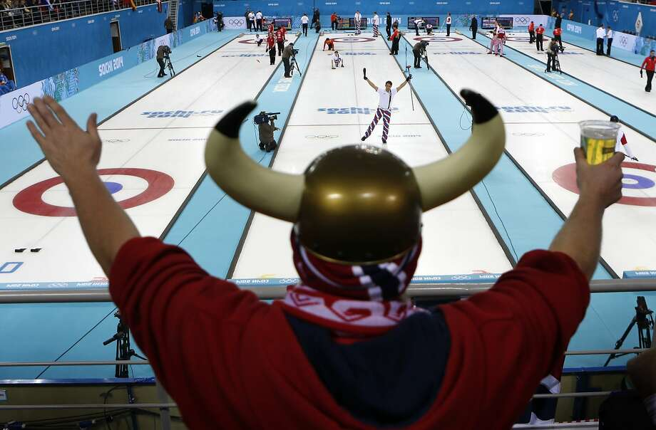 Number one fan: Norwegian skipper Thomas Ulsrud acknowledges the cheers of curling supporter Rune Eikeland during the team's match with China at the Sochi Olympics. Photo: Robert F. Bukaty, Associated Press