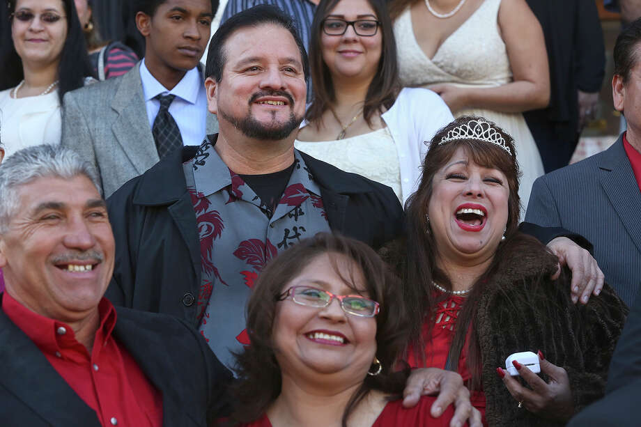 Couples including Edgar and Ernestina Gonzalez, front/left, and Ernest and Josie Chavez participate in a mass wedding on the steps of the Bexar County Courthouse in San Antonio on Friday, Feb. 14, 2014. Photo: LISA KRANTZ, SAN ANTONIO EXPRESS-NEWS / SAN ANTONIO EXPRESS-NEWS