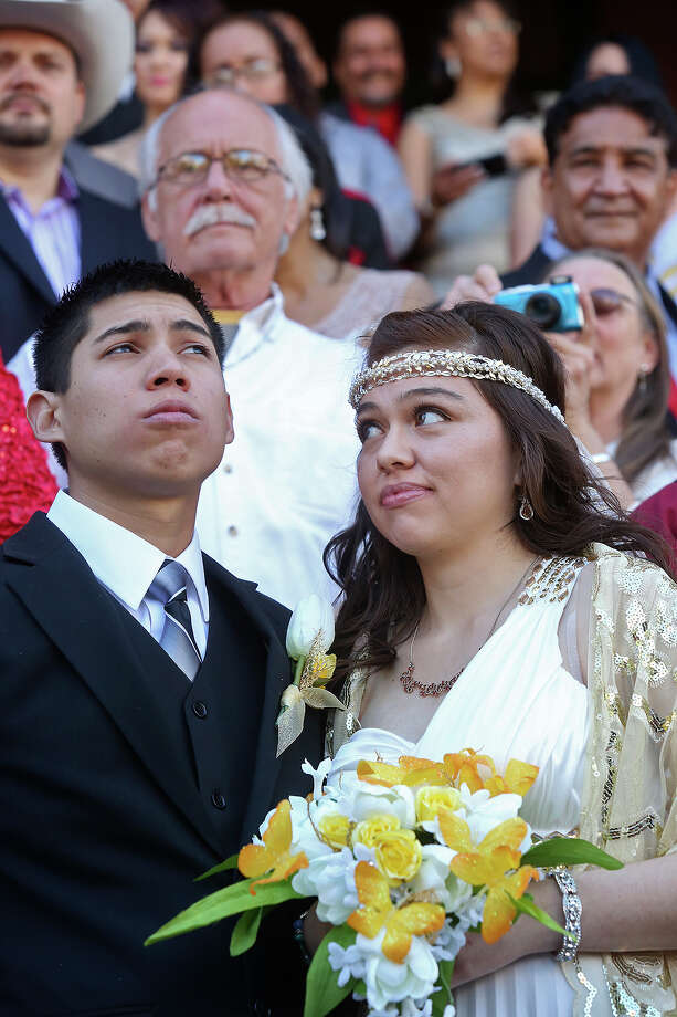 Analicia Vazquez and John Vazquez participate in a mass wedding on the steps of the Bexar County Courthouse in San Antonio on Friday, Feb. 14, 2014. Photo: LISA KRANTZ, SAN ANTONIO EXPRESS-NEWS / SAN ANTONIO EXPRESS-NEWS