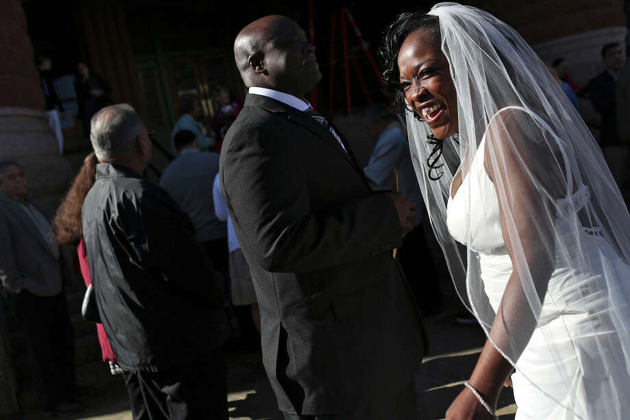 Erma Prince waits to marry Lonnie Hines before a mass wedding on the steps of the Bexar County Courthouse in San Antonio on Friday, Feb. 14, 2014. The couple has been together for 14 years. Photo: LISA KRANTZ, SAN ANTONIO EXPRESS-NEWS / SAN ANTONIO EXPRESS-NEWS