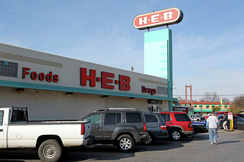 Customers visit a busy H.E.B. at 1601 Nogalitos on February 5, 2014.